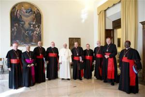 Pope Francis poses with cardinals during a meeting at the Vatican