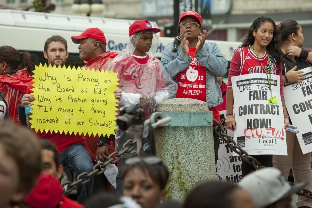 Public school teachers rally at Chicago's Congress Plaza to protest against billionaire Hyatt Hotel mogul Penny Pritzker, who is also a member of the Chicago Board of Education on Thursday, Sept. 13,