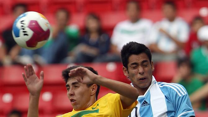 Brazil's Henrique Ribeiro (6) and Argentina's Sergio Araujo, right, go for a header during a men's soccer match at the Pan American Games in Guadalajara, Mexico, Wednesday, Oct. 19, 2011. (AP Photo/Juan Karita)