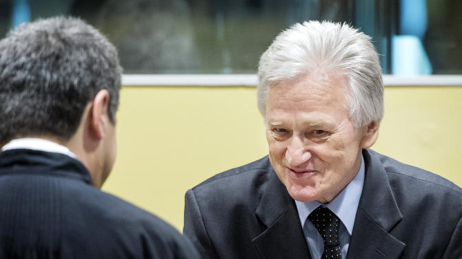 Gen. Momcilo Perisic, the former chief of staff of the Yugoslav national army, right, talks to his lawyer prior to his appeal judgment in the court room of the Yugoslav war crimes tribunal in The Hague, Netherlands, Thursday Feb. 28, 2013. Prosecutors accused Perisic of providing crucial military aid to rebel Serb forces responsible for the atrocities including the Srebrenica massacre and siege of Sarajevo. Perisic's 2011 conviction and 27-year sentence marked the first time the U.N. court had found a civilian or military officer from Serbia guilty of war crimes in Bosnia. (AP Photo/Koen van Weel, Pool)