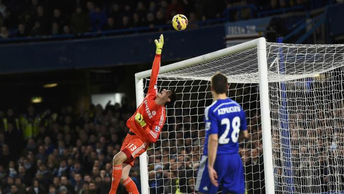 Chelsea goalkeeper Thibaut Courtois makes a save during their English Premier League soccer match against Manchester City at Stamford Bridge in London