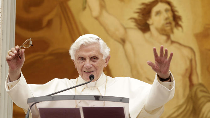 """Pope Benedict XVI waves to faithful during the Angelus prayer at his summer residence of Castel Gandolfo, in the outskirts of Rome, Sunday, July 22, 2012. Benedict XVI says he's """"deeply shocked"""" by the """"senseless violence"""" in the Colorado movie theater shootings and is offering his prayers so the survivors and relatives of the victims can find strength. He also said he hopes the Olympics Games starting July 27 in London will help promote peace and reconciliation in the world. (AP Photo/Riccardo De Luca)"""