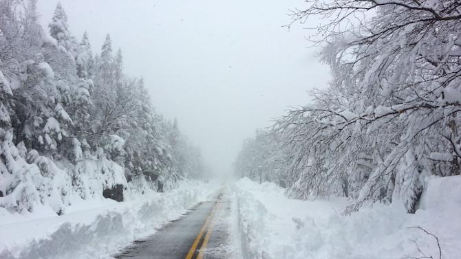 This photo provided courtesy of ORDA/Whiteface shows Whiteface Mountain Veterans' Memorial Highway after a heavy snowfall Sunday, May 26, 2013. The late-May storm has dropped three feet of snow on the New York ski mountain near the Vermont boarder. Whiteface Mountain spokesman Jon Lundin says 36 inches of white powder have fallen on the nearly 5,000-foot tall mountain in the Adirondacks, forcing the Olympic Regional Development Authority to close Whiteface Veteran's Memorial Highway on the backside of the mountain. (AP Photo/courtesy of ORDA/Whiteface)