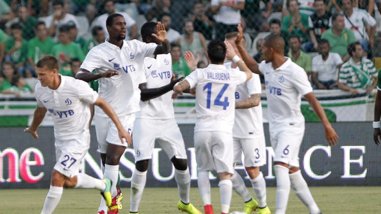 Players of Dinamo Moskva celebrate a goal against Omonia Nicosia during the Europa League play-offs second leg soccer match at GSP stadium in Nicosia, Cyprus, Thursday, Aug. 28, 2014. (AP Photo/Petros Karadjias)
