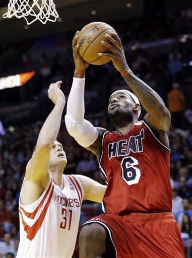 James, Wade score 63, Heat top Rockets 114-108