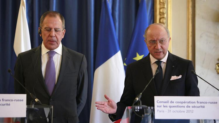 Russian foreign minister Sergei Lavrov, left, attends a news conference with his French counterpart Laurent Fabius at the French foreign ministry, Paris, Wednesday, Oct. 31 2012. French and Russian ministers are engaged in bilateral cooperation talks. (AP Photo/Thibault Camus)