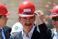 Brazilian Sport Minister Aldo Rebelo adjusts his hard hat as he visits the Maracana stadium works in Rio de Janeiro in March 2012. Brazilian Sports Minister Aldo Rebelo will meet in Zurich next week with FIFA secretary general Jerome Valcke for the first time since the latter caused an uproar with his criticism of the country's 2014 World Cup preparations