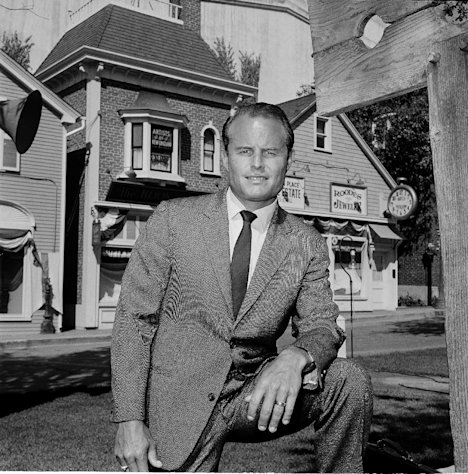 "FILE - In this July 29, 1964 file photo, Richard Zanuck, 29, is shown as production manager at Twentieth Century-Fox studio in Los Angeles. Zanuck, the son of Darryl F. Zanuck, has been schooled by his father in all phases of the business. Less flamboyant than his father, Richard is a 24-hour-a-day worker, ""tough but basically a gentleman,"" as one associate puts it. He's pictured at his desk reading scripts, which he regards as his No. 1 chore, looking at film strips,"" and on the exterior set of ""Peyton Place"" where a TV series is filmed. According to his publicist, Richard D. Zanuck has died at age 77 in Los Angeles, on Friday, July 13, 2012. He won an Oscar for best picture for his film, ""Driving Miss Daisy."" (AP Photo/DAB, File)"