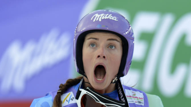 Slovenia'sTina Maze reacts as she see United States'LindseyVonn crashing during the women's super-G at the Alpine skiing world championships in Schladming, Austria, Tuesday, Feb.5,2013. (AP Photo/Kerstin Joensson)