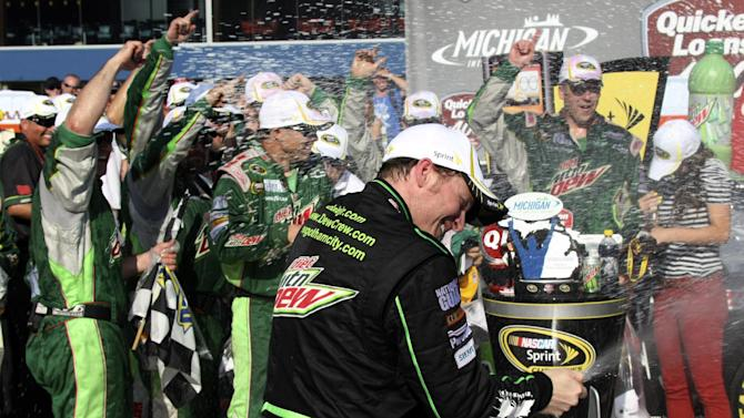 Dale Earnhardt Jr. celebrates after winning the NASCAR Sprint Cup Series Quicken Loans 400 auto race at Michigan International Speedway, Sunday, June 17, 2012, in Brooklyn, Mich. (AP Photo/Bob Brodbeck)