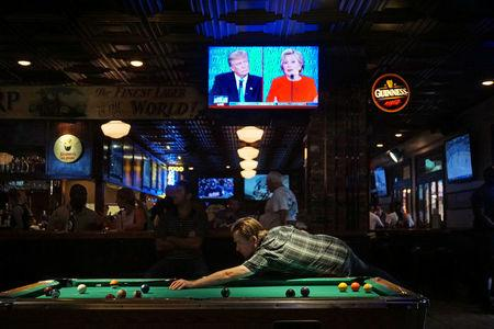 Patrons at McGregor's Bar and Grill watch the first televised debate between Democratic presidential candidate Hillary Clinton and Republican presidential candidate Donald Trump in San Diego