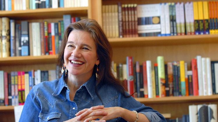 "FILE - This May 16, 2008 file photo shows author Louise Erdrich at her store BirchBark Books in Minneapolis. Erdrich, 58, won a National Book Award Wednesday, Nov. 14, 2012, for her story, ""The Round House"" the second of a planned trilogy, about an Ojibwe boy and his quest to avenge his mother's rape. Erdrich, who's part Ojibwe, spoke in her tribal tongue and then switched to English as she dedicated her fiction award to ""the grace and endurance of native people."" (AP Photo/Dawn Villella, file)"