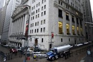 The New York Stock Exchange is seen as New Yorkers clean up the morning after Sandy made landfall. The Twitter &quot;troll&quot; who became an online villain after several false tweets about the destruction of Hurricane Sandy has apologized and resigned from a Republican congressional campaign