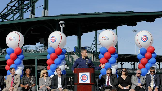 Chicago Cubs President of Baseball Operations, Theo Epstein, speaks during a ceremony to unveil the Cubs' new Cactus League spring training baseball facility, Wednesday, Feb. 12, 2014, in Mesa, Ariz