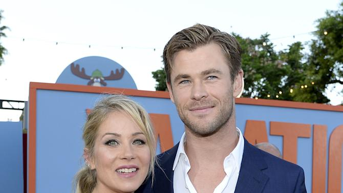 """Cast members Christina Applegate and Chris Hemsworth pose during the premiere of the film """"Vacation"""" at the Regency Village Theatre in the Westwood section of Los Angeles"""