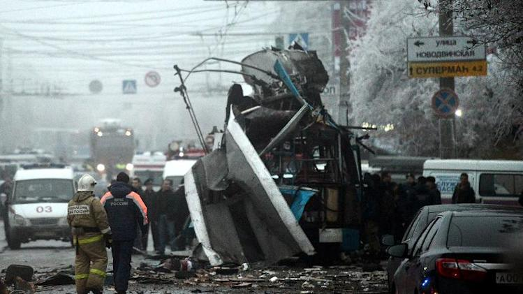 Russian firefighters and security personnel inspect the trolleybus destroyed in a bomb attack in Volgograd on December 30, 2013