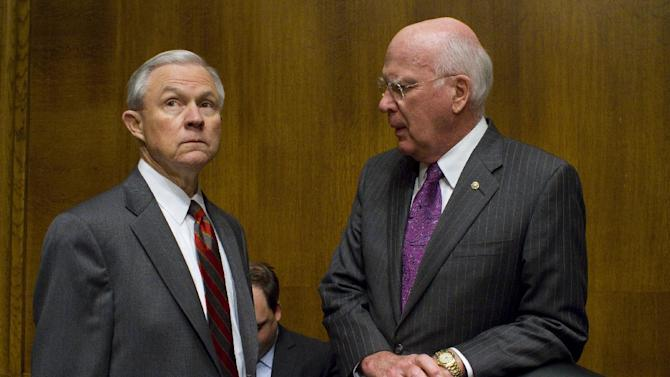 CORRECTS SENATOR LEAHY'S PLAN FOR IMMIGRATION - FILE - In this May 11, 2010 file photo, Senate Judiciary Committee Ranking Member, Republican Jeff Sessions, R-Ala., left, and Democrat Chairman Patrick Leahy, D-Vt., confer before an Immigration hearing on Capitol Hill in Washington.   As the Senate Judiciary Committee prepares to begin voting this week on far-reaching immigration legislation, advocates are watching warily to see whether relatively tame opposition balloons into the kind of fierce resistance that killed Congress' last attempt to overhaul the system.   (AP Photo/Harry Hamburg)