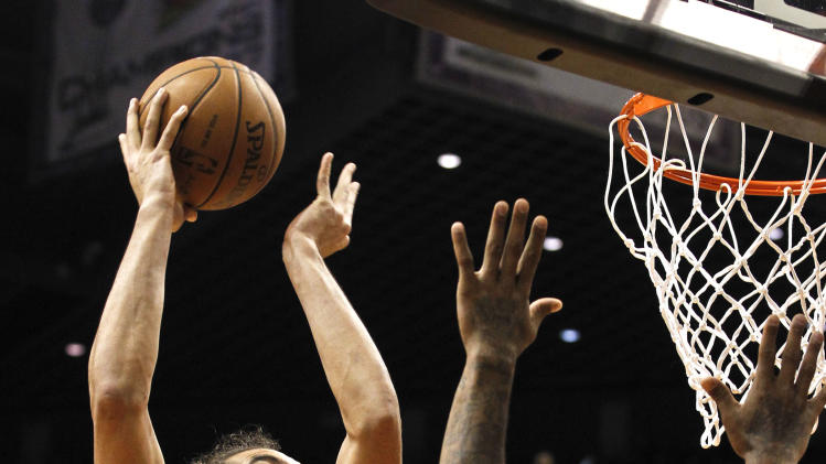 Chicago Bulls' Joakim Noah (13) shoots over Phoenix Suns' P.J. Tucker (17) during the first half of an NBA basketball game, Wednesday, Nov. 14, 2012, in Phoenix. (AP Photo/Ross D. Franklin)