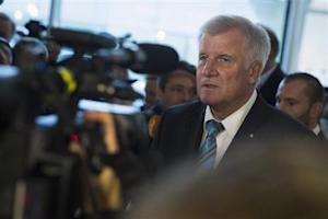 CSU leader Seehofer talks with journalists before first CDU/CSU parliamentary faction meeting after general election in Berlin