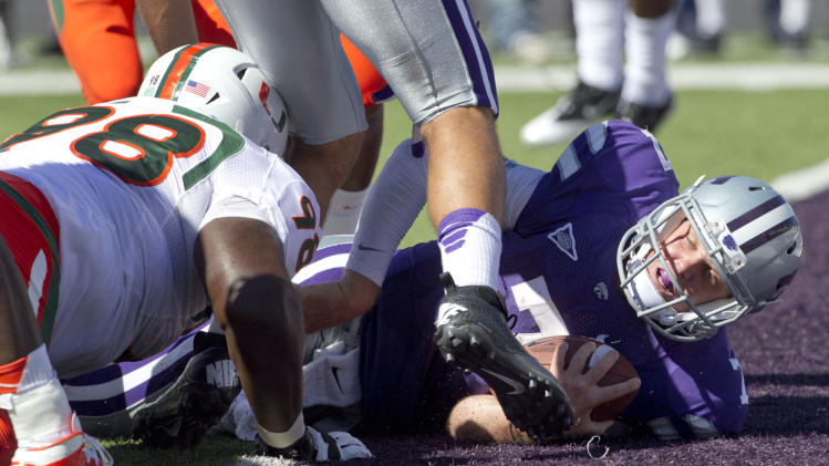 Kansas State quarterback Collin Klein (7) lands in the end zone past Miami defensive lineman Darius Smith (98) during the first half of an NCAA football game in Manhattan, Kan., Saturday, Sept. 8, 2012. (AP Photo/Orlin Wagner)