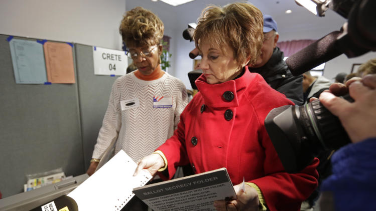 Former Democratic U.S. Rep. Debbie Halvorson casts her vote in Steger, Ill., Tuesday, Feb. 26, 2013, in the special primary election to replace former U.S. Rep. Jesse Jackson in Illinois' 2nd Congressional District. Halvorson is one of the front-runners in the primary.  The others include former state Rep. Robin Kelly and Chicago Alderman Anthony Beale. They were among 14 Democrats and four Republicans in the special primary, but the Democratic winner is expected to sail through the April 9 general election because of the heavily Democratic region. (AP Photo/M. Spencer Green)