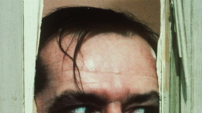 """FILE - In this undated file photo originally released by Warner Bros., Jack Nicholson portrays Jack Torrance in a scene from the movie """"The Shining."""" Some think Stanley Kubrick's """"The Shining"""" is a horror masterpiece. Others find it a mix between overblown fright flick and art film. """"Room 237,"""" a documentary playing the Toronto International Film Festival, attempts to decrypt the adaptation of the Stephen King horror novel, providing no definitive answers yet offering a fascinating glimpse into the enigma of Kubrick himself. (AP Photo/Warner Bros. Inc., file)"""