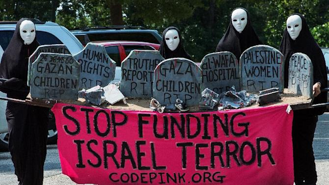 """Members of Code Pink hold a vigil of civil disobedience and conduct a """"die-in"""" in front of the Israeli Embassy July 30, 2014, protesting the deaths of Palestinians in Gaza"""