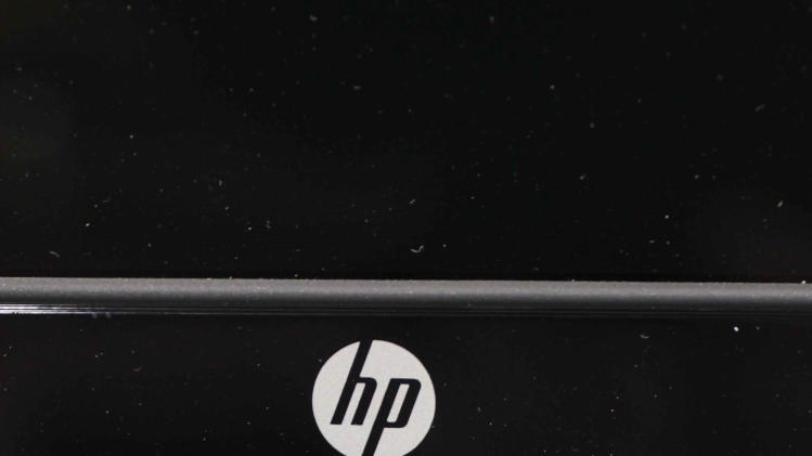In this Monday, Aug. 20, 2012, photo, a Hewlett Packard keyboard is displayed at a Best Buy store in Mountain View, Calif. On Wednesday, Aug. 22, 2012, Hewlett-Packard Co. said it suffered an $8.9 billion loss during its most recent quarter after taking a previously announced charge against earnings for an acquisition that hasn't panned out the way management envisioned. The maker of personal computers is struggling to compete with mobile devices. (AP Photo/Paul Sakuma)