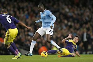 Manchester City's Toure is challenged by Swansea's Hernandez during their English Premier League soccer match at the Etihad stadium in Manchester