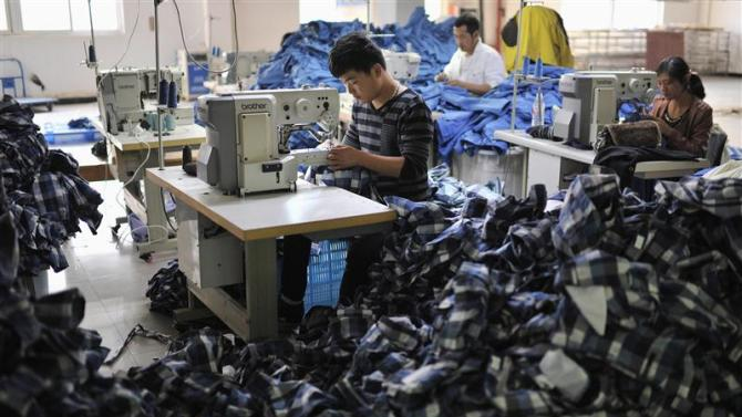 Employees work inside a factory manufacturing clothes for export, in Wuhu