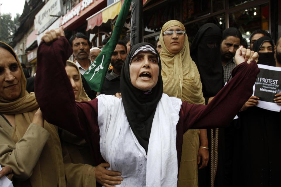 "Yasmeen Raja, chairperson of Muslim Khawateen Markaz, or Muslim Women's Center, shouts slogans during a protest in Srinagar, India, Monday, Sept. 17, 2012. The protest was held against an anti-Islam film called ""Innocence of Muslims"" that ridicules Islam's Prophet Muhammad. (AP Photo/Mukhtar Khan)"