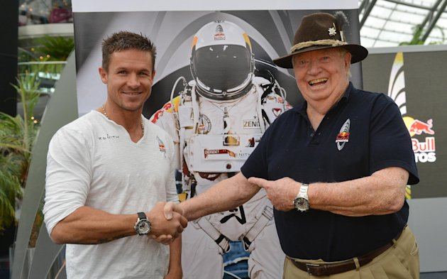 Austria's Felix Baumgartner, left, and Col. Joe Kittinger pose for the photographers after a press conference in Salzburg, Austria , on Saturday Oct. 27, 2012. Supersonic skydiver Felix Baumgartner has finally come home after his death-defying, record-breaking leap from the edge of space. The Austrian former military parachutist faced reporters in his home city of Salzburg on Saturday, nearly two weeks after his plunge from a balloon to the New Mexico desert made him the first person to reach supersonic speed without traveling in a jet or spacecraft. (AP Photo/Kerstin Joensson),