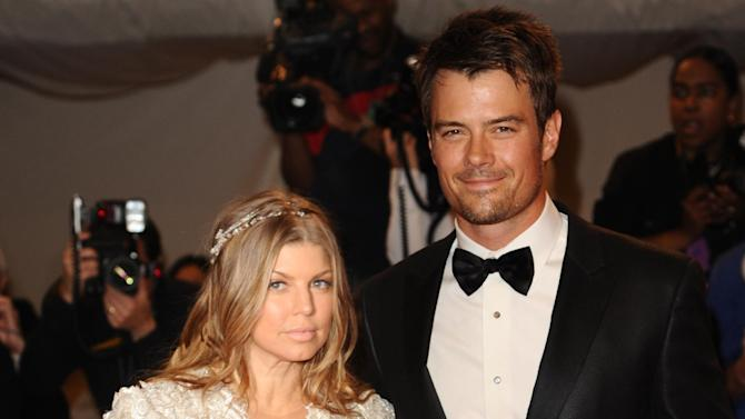FILE - This is a Monday May 2, 2011 file photo of singer Fergie and her husband, actor Josh Duhamel, arrive at the Metropolitan Museum of Art Costume Institute gala, Monday, May 2, 2011 in New York. Actor Josh Duhamel and his wife, Black Eyed Peas singer Fergie, have already started doing their homework as they prepare to welcome their first child they said Wednesday Feb. 20, 2013.  (AP Photos/Peter Kramer, File)