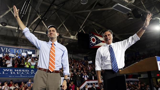 U.S. Secret Service agents stand watch as Republican presidential candidate and former Massachusetts Gov. Mitt Romney and vice presidential candidate Rep. Paul Ryan, R-Wis., campaign at the Celina Fieldhouse in Celina, Ohio, Sunday, Oct. 28, 2012. (AP Photo/Charles Dharapak)