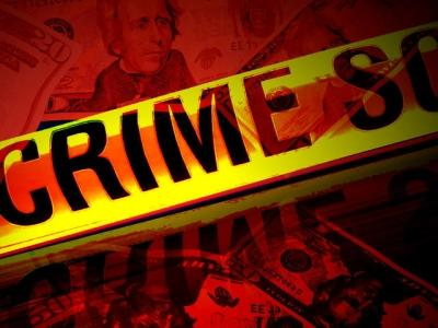 Man Accused of Robbing Bank Waits for Police