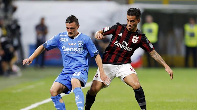 AC Milan's Suso and Empoli's Rui fight for the ball during their Serie A soccer match in Milan