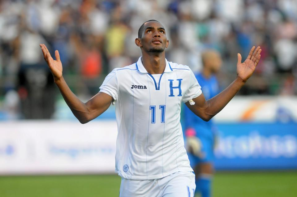 Honduras' Jerry Bengtson celebrates after scoring against U.S. during a 2014 World Cup qualifying soccer game in San Pedro Sula, Honduras, Wednesday Feb. 6, 2013. Honduras won 2-1. (AP Photo/Fernando Antonio)