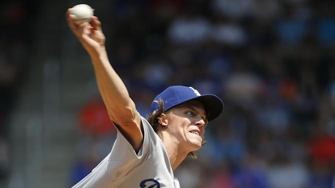 Los Angeles Dodgers starting pitcher Zack Greinke delivers in a baseball game against the New York Mets in New York, Tuesday, July 28, 2015. (AP Photo/Kathy Willens)