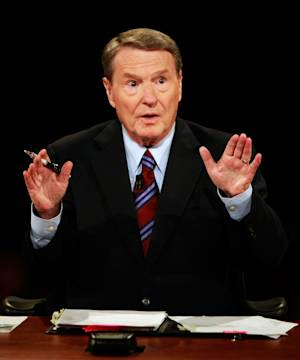 "FILE - In this Sept. 26, 2008 file photo, veteran PBS anchor and debate moderator Jim Lehrer asks a question during the first U.S. Presidential Debate between presidential nominees Sen. John McCain, R-Ariz., and Sen. Barack Obama, D-Ill., at the University of Mississippi in Oxford, Miss. Lehrer, now in semi-retirement at age 77, said he's through after moderating 11 presidential debates between 1988 and 2008. That's one of the reasons he wrote the new book ""Tension City: My View From the Middle Seat,"" an account of the debates he's been involved in from his perspective and that of the candidates. (AP Photo/Chip Somodevilla, Pool)"