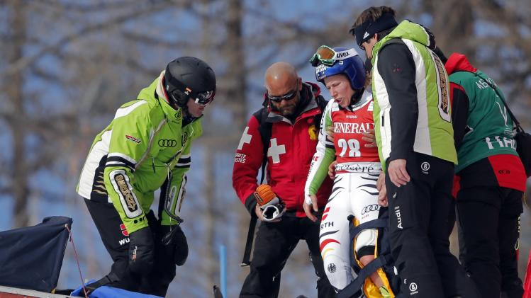 Germany's Hronek receives assistance after crashing during the Women's World Cup Giant Slalom skiing race in Val d'Isere