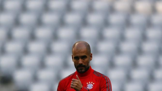 Munich's Guardiola conducts a training session before their Champions League group E soccer match against Manchester City, in Munich