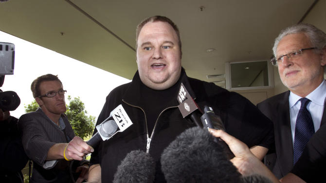 "FILE - In this Feb. 22, 2012 file photo, Kim Dotcom, the founder of the file-sharing website Megaupload, comments after he was granted bail and released in Auckland, New Zealand. Indicted Megaupload founder Kim Dotcom has launched a new file-sharing website in a defiant move against the U.S. prosecutors who accuse him of facilitating massive online piracy. The colorful entrepreneur unveiled the ""Mega"" site ahead of a lavish gala and press conference planned at his New Zealand mansion on Sunday night, Jan. 20, 2013. (AP Photo/New Zealand Herald, Brett Phibbs, File) NEW ZEALAND OUT, AUSTRALIA OUT"