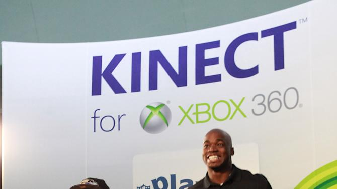 Young Estevan Rico competes against NFL running back Adrian Peterson at Kinect for Xbox 360, on Thursday, Jan. 31, 2013 in New Orleans, LA. (Photo by Barry Brecheisen/Invision for Xbox/AP Images)