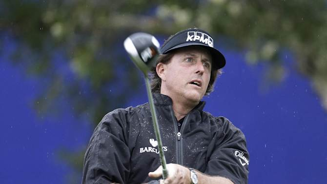 Phil Mickelson watches his tee shot on the seventh hole of the South Course at Torrey Pines during the second round of the Farmers Insurance Open golf tournament Friday, Jan. 25, 2013, in San Diego. (AP Photo/Lenny Ignelzi)