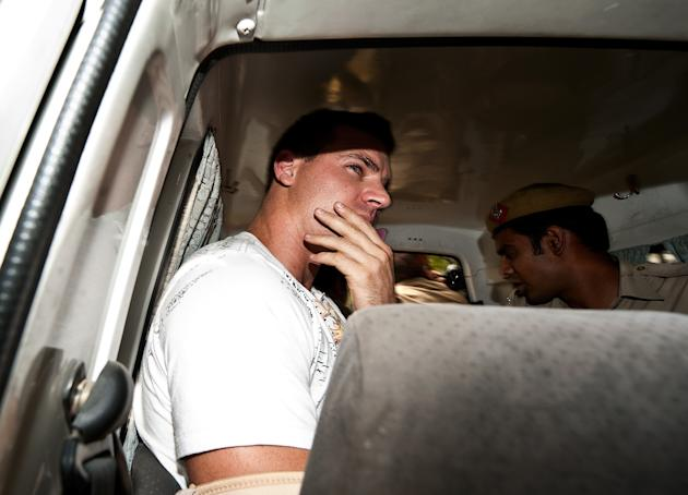 Australian cricketer and Royal Challengers Bangalore team player Luke Pomersbach is escorted in a police vehicle to Patiala House court in New Delhi on May 18, 2012.  Indian police have arrested and c