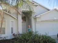 Laura Quinn standing in front of her Florida home, which she refinanced at 2.75 percent.