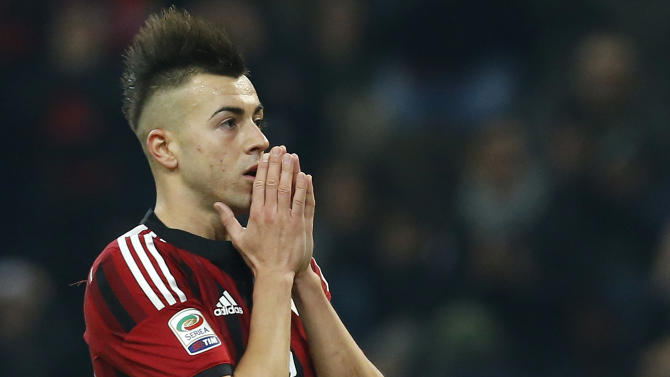 AC Milan's El Shaarawy reacts after missing a goal opportunity against Inter Milan during their Italian Serie A soccer match at the San Siro stadium in Milan