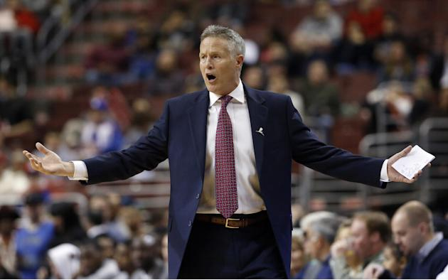 Philadelphia 76ers head coach Brett Brown reacts to a call during the first half of an NBA basketball game against the Utah Jazz, Saturday, March 8, 2014, in Philadelphia