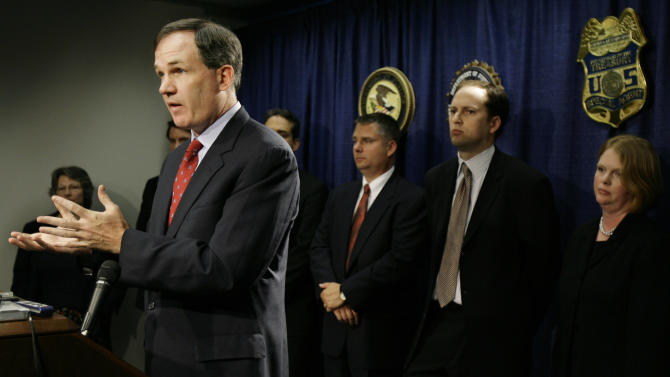 FILE -In this Oct. 11, 2006 file photo, former U.S. Attorney Patrick Fitzgerald speaks at a news conference  in Chicago. Fitzgerald, who recently resigned after 11 years as head of the U.S. Attorney's Office in Chicago to enter private practice, made a name for himself as one of the most tenacious and successful federal prosecutors in recent history by putting two former Illinois governors and dozens of their cronies behind bars. White House officials will name a replacement to Fitzgerald in the next several weeks from a list of four finalists for what is arguably Chicago's second most powerful job, next only to Rahm Emanuel's job as mayor. (AP Photo/M. Spencer Green, File )