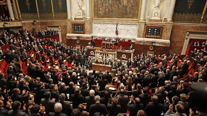 French leftist deputies, foreground and right, applaud following the vote at the National Assembly in Paris, Tuesday Feb. 12, 2013, of a new law legalizing gay marriage.  France's lower house of parliament has approved a sweeping bill to legalize gay marriage and allow same-sex couples to adopt children. President Francois Hollande's Socialists have pushed the measure through the National Assembly and put France on track to join about a dozen, mostly European nations that grant marriage and adoption rights to homosexuals. (AP Photo/Remy de la Mauviniere)